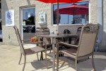 Outdoor waiting table and chairs in our Northridge, CA Cadillac Auto Repair Shop